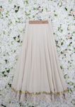 white lehenga skirt with two layers of rose gold print