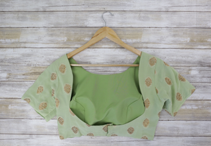 soft sea green short sleeved blouse with gold brocade and small open back