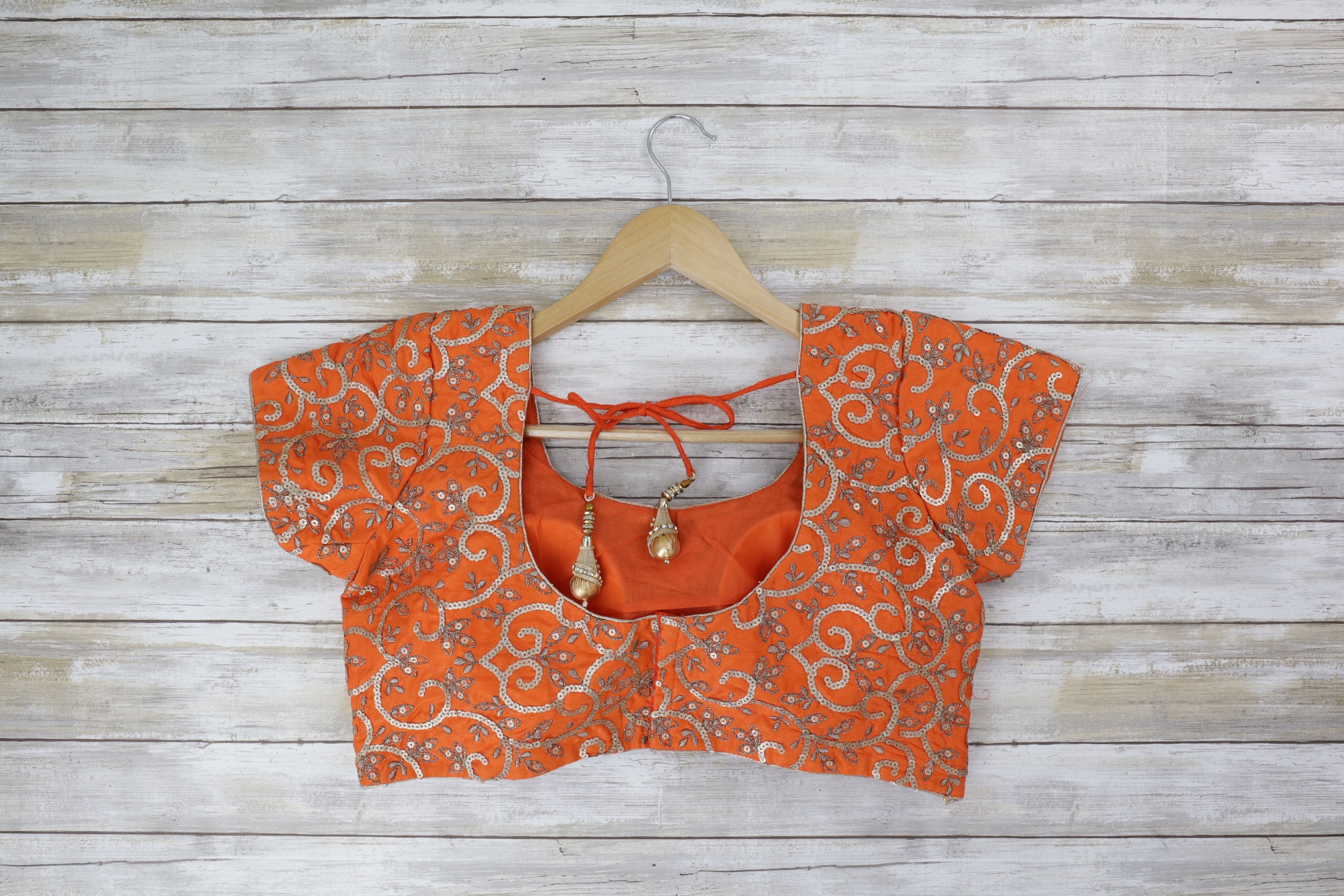 Back deep back orange blouse featuring gold sequin and embroidery in a flattering short sleeve shape