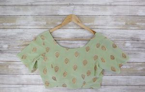 soft sea green short sleeved blouse with gold brocade