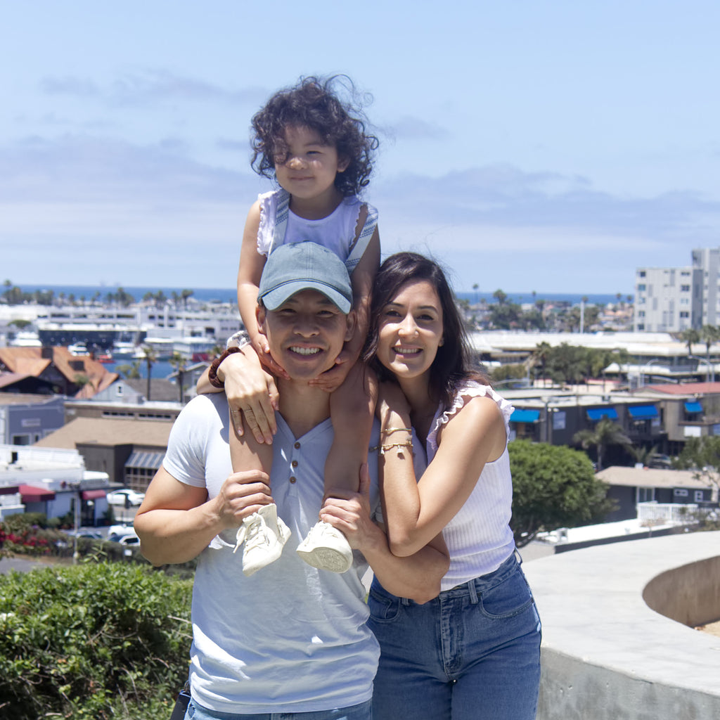 Black Finch founders and owners Tom and Maria Tu with baby Tommie in Newport Beach, California
