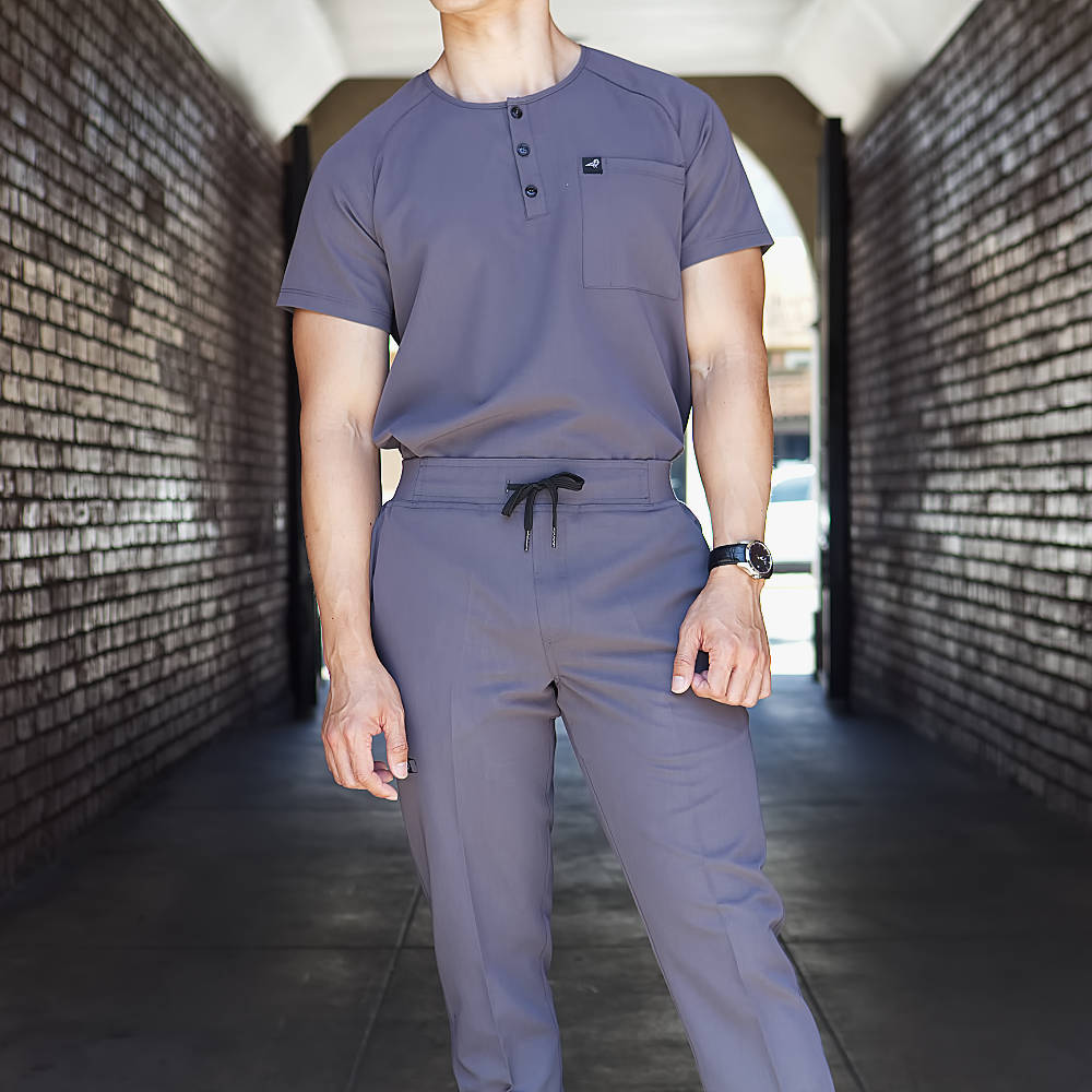 Black Finch Men's Slim Fit Scrub Impact Top and Rogue Pant in Gray Tucked in