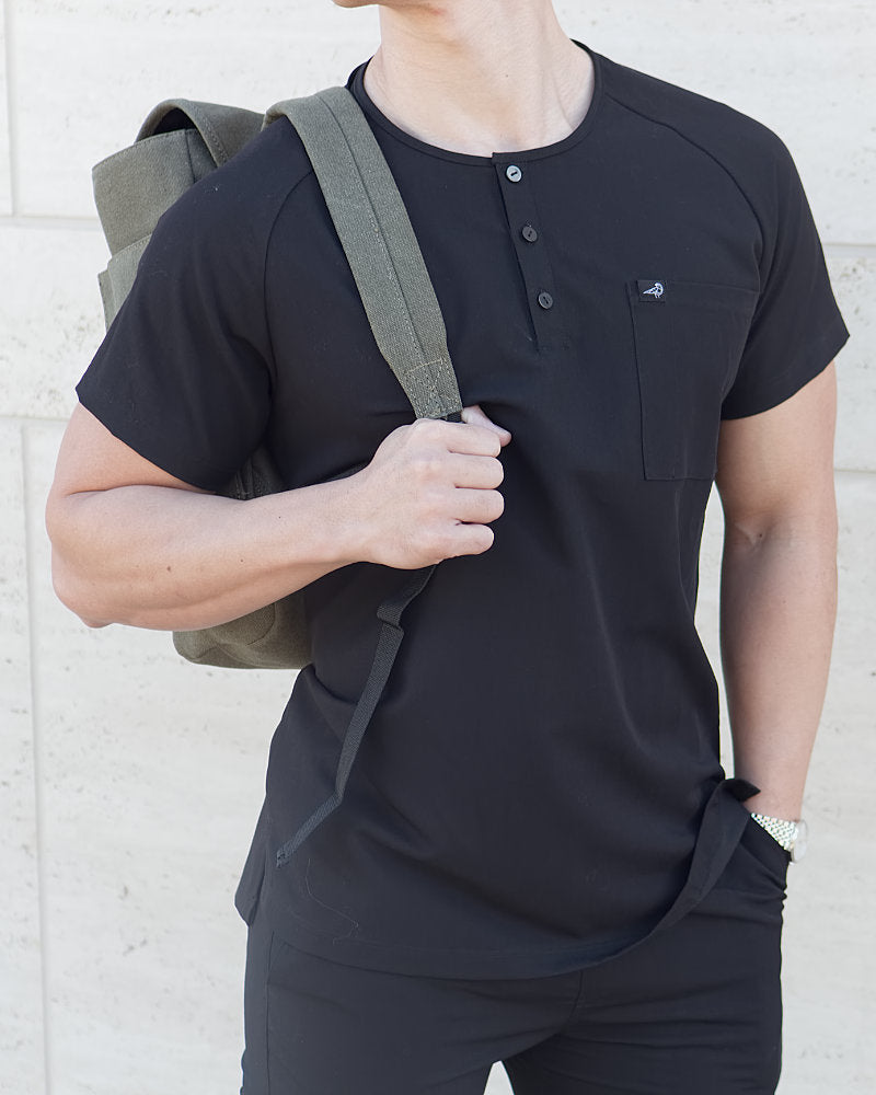 Black Finch Scrubs Impact top, men's scrub top in black untucked for the medical student. Slim fit and tailored to perfection.