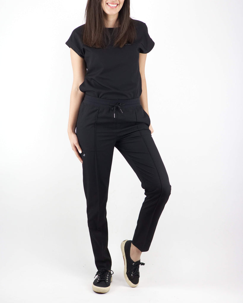 Black Finch Scrubs women's Blackburn pants in black.  Slim Fit scrub bottoms with pintuck details, elastic waistband and drawstring.