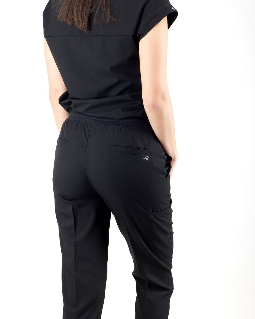 Black Finch Scrubs women's Blackburn pants in black.  Slim Fit scrub bottoms with five pockets including a welt cargo pocket.