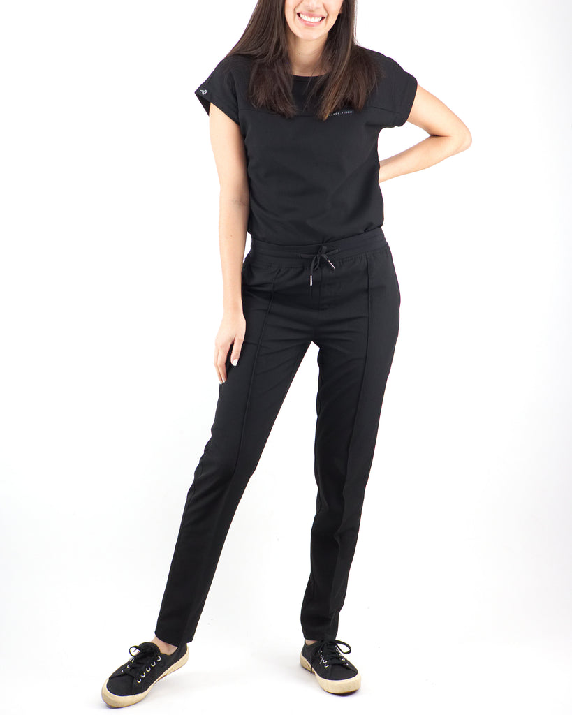 Black Finch Scrubs women's Blackburn pants in black.  Slim Fit scrub bottoms with soft high quality fabric.  Four way stretch, moisture wicking, wrinkle resistant, and anti-microbial.