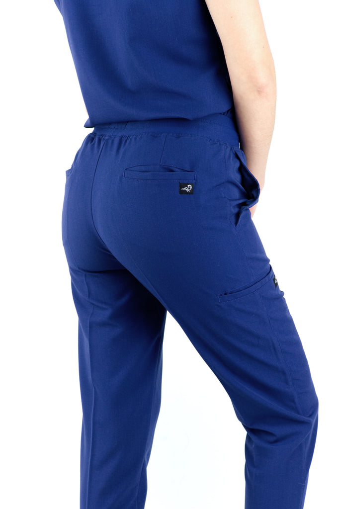 Black Finch Scrubs women's Blackburn pants in midnight blue.  Slim Fit scrub bottoms with pintuck details, elastic waistband and drawstring.