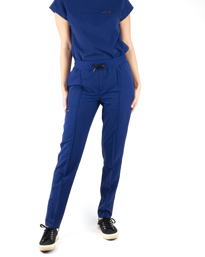 Black Finch Scrubs women's Blackburn pants in midnight blue.  Slim Fit scrub bottoms with soft high quality fabric.  Four way stretch, moisture wicking, wrinkle resistant, and anti-microbial.