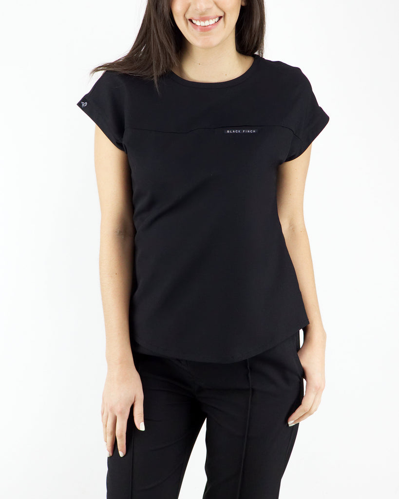 Black Finch Scrubs women's Elion Top in black.  Three pockets scrub top.