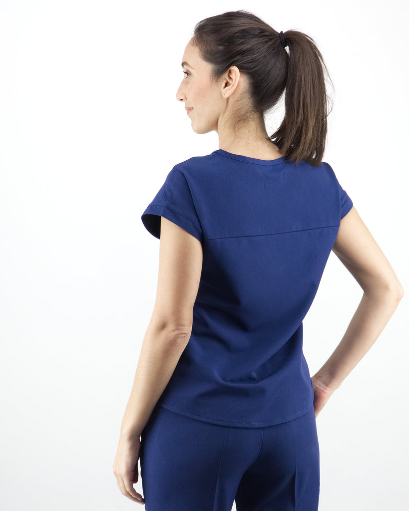 Black Finch Scrubs women's Elion Top in Midnight Blue.  Front and Back Yoke.  Curved Hem.