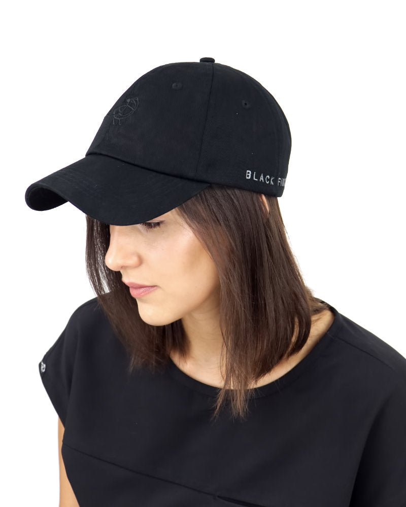 Black Finch Midnight Unisex Dad Hat in black side view on a model.