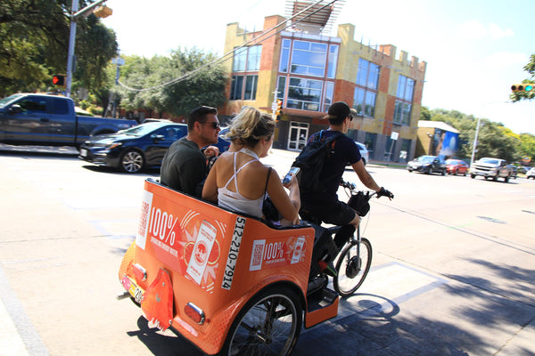 CAPTION Gabe giving some people a ride to ACL