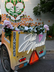 "Purchase a Neon ""Just Married"" Sign & Reserve Premium Service"