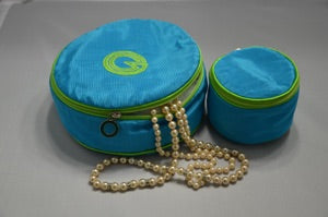 Large and small round jewel case in blue with lime trim