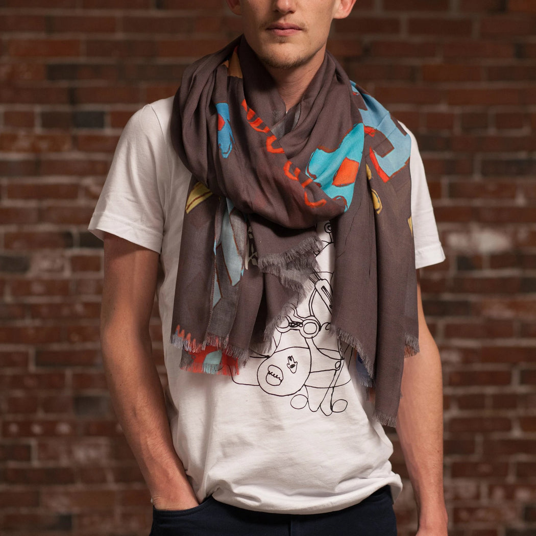 Djenné Wahala Mud Large Art Cashmere Blend Scarf loose wrap on male model in white t-shirt