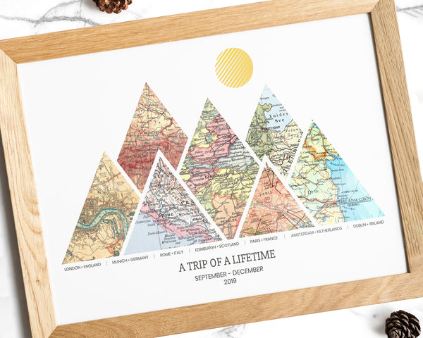 A personalized adventure map print with seven triangular vintage map sections in wooden frame