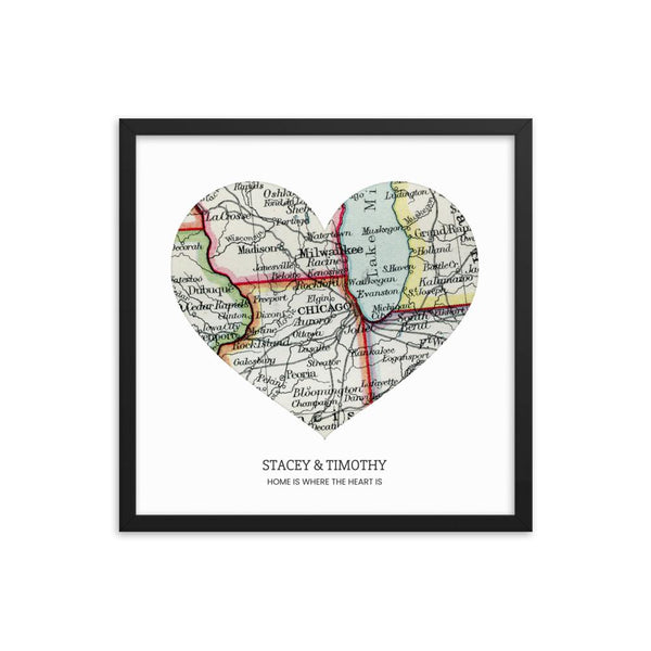 A personalized heart shaped vintage map art print enclosed in a black frame