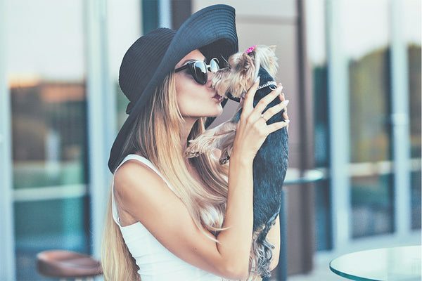 signs your lover isn't a dog lover, woman loves dog, puppy kisses