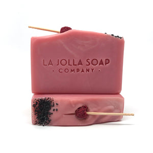 A lovely plant based blend of moisture rich ingredients, organic olive oil and raw organic shea butter, both high in vitamin E and antioxidants.  Blended with rich mineral clay creating a beautiful pink color, then topped with black sea salt and raspberry.  This bath-art soap creates a bubbly lather that gently cleanses while the fresh tart aroma uplifts your spirits. Notes of mixed berries, cactus flower and a kiss of black pepper.
