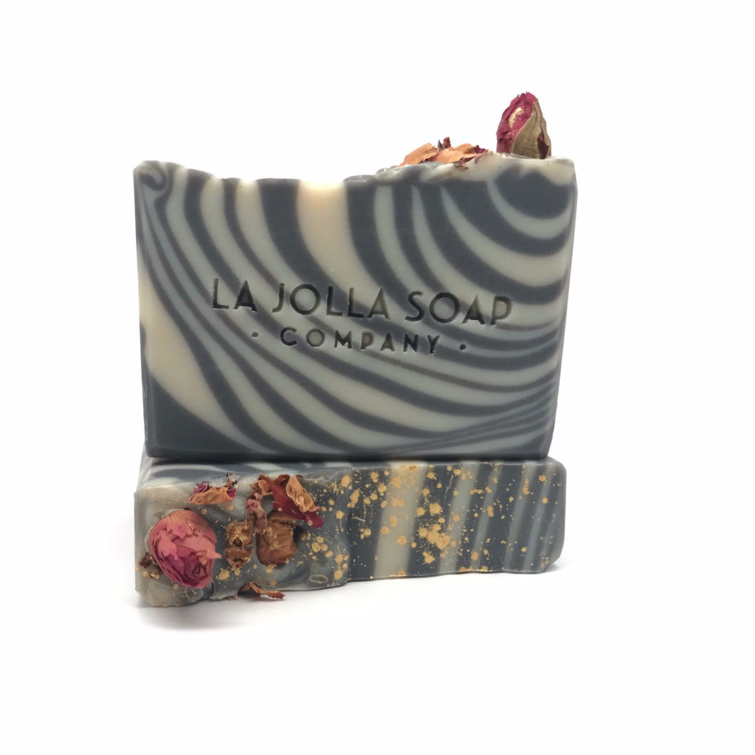 This beautiful artisan soap creates a bubbly lather that gently cleanses while maintaining your skin's natural moisture balance.  You will enjoy a fun playful scent of plum jam with notes of black rose.