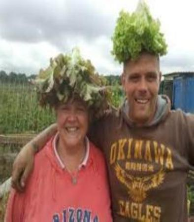 <y name Rudy and this is Barb together we like growing Rhubarb. We plant many Rhubarb as they are easy to grow. Buy many and make Rhubarb Pie.