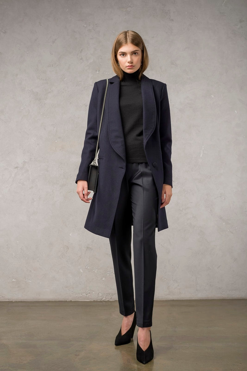 The Asymmetric Blue Coat