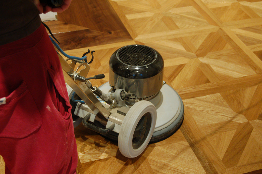 buffing a parquet wood floor