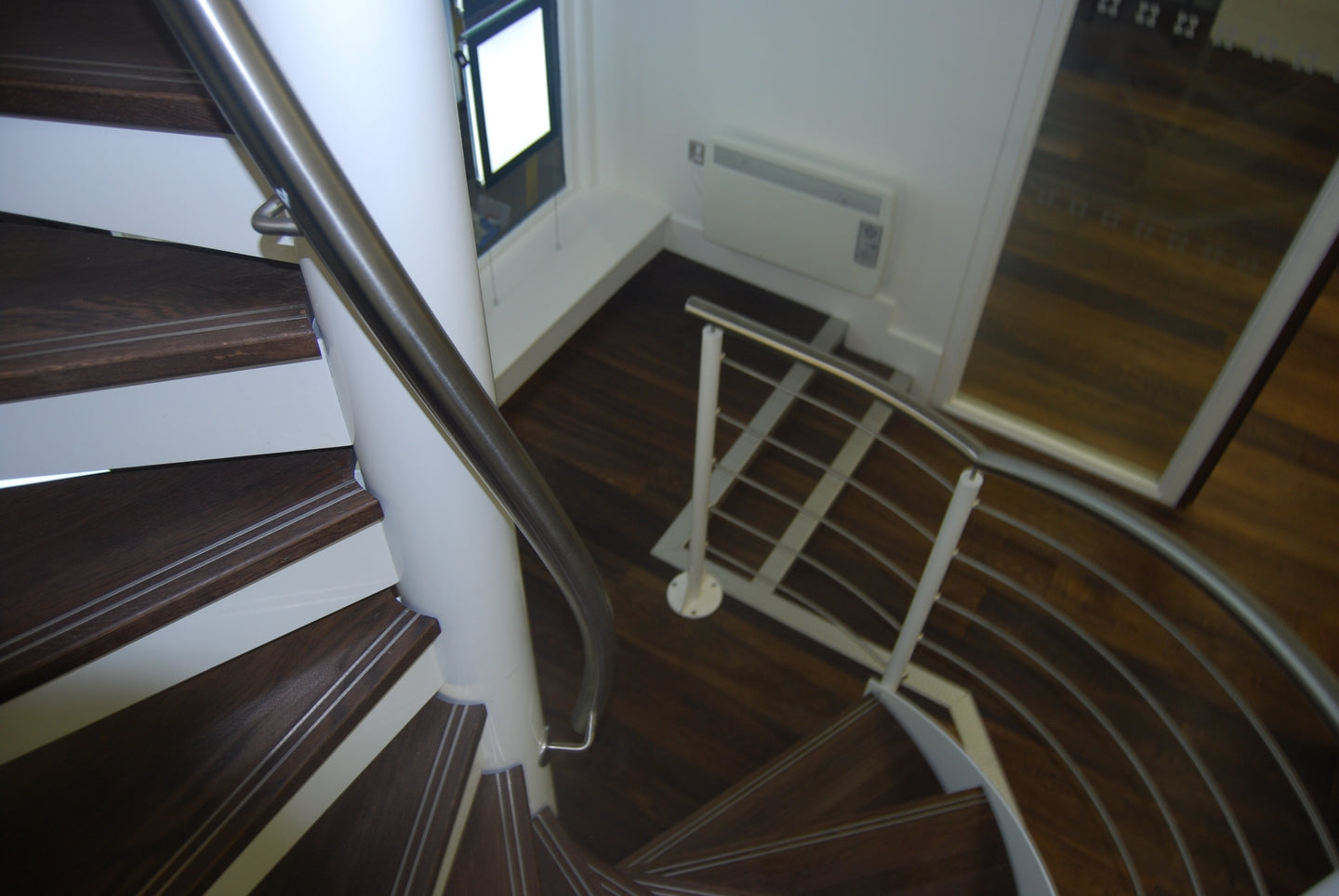 Metal edges on stairway for Health and Safety regulations.  Fumed Doubled Brushed Oak.