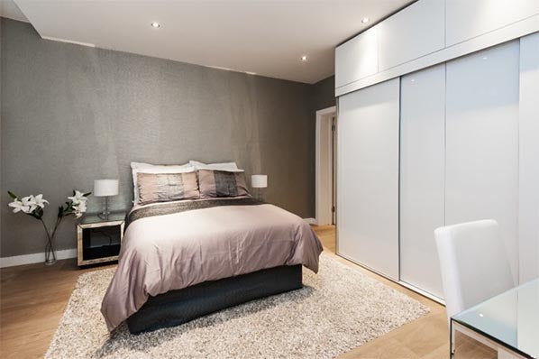 Oak flooring used in modern looking bedroom