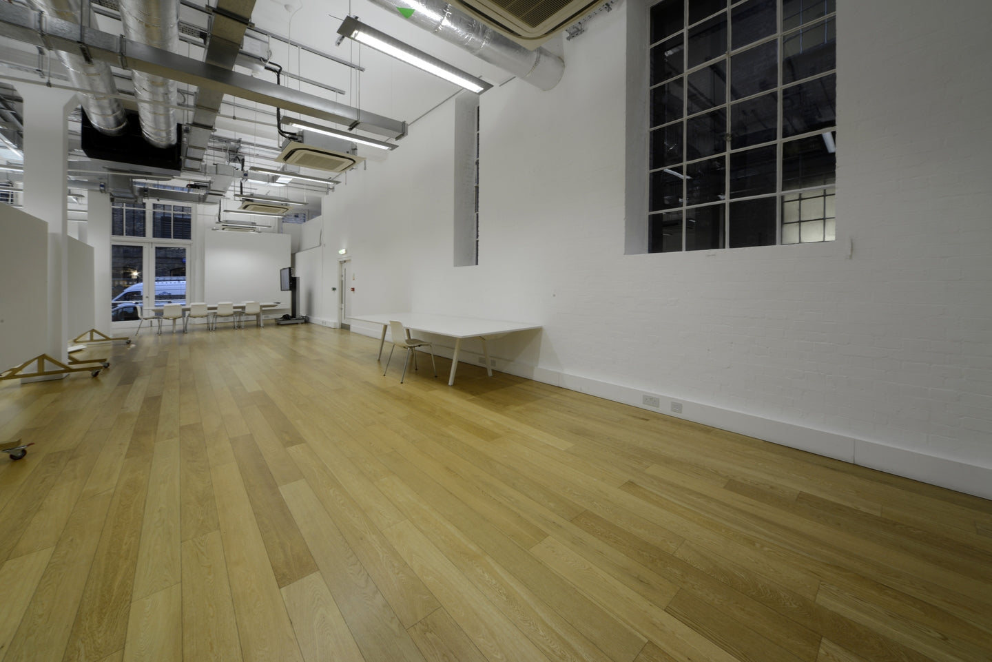 Easy to maintain lacquered prime oak flooring in KPF London Office