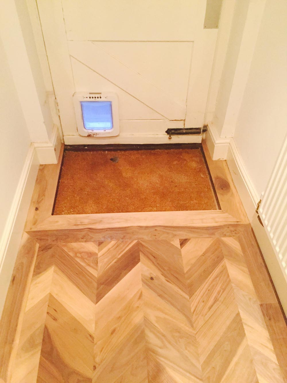 Walnut Chevron floor up to doorway