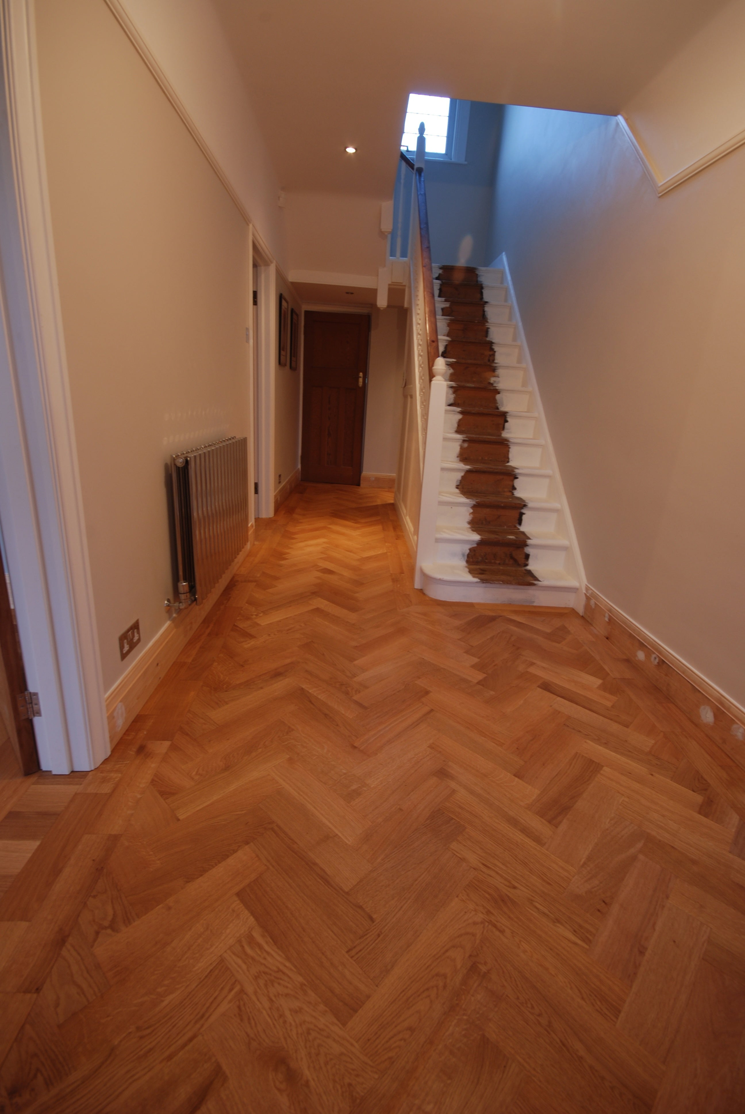 Parquet flooring being installed in hallway