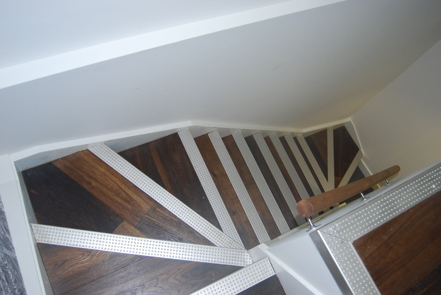 E151   Double Brushed Fumed Oak Flooring clad to stairs with metal inserts