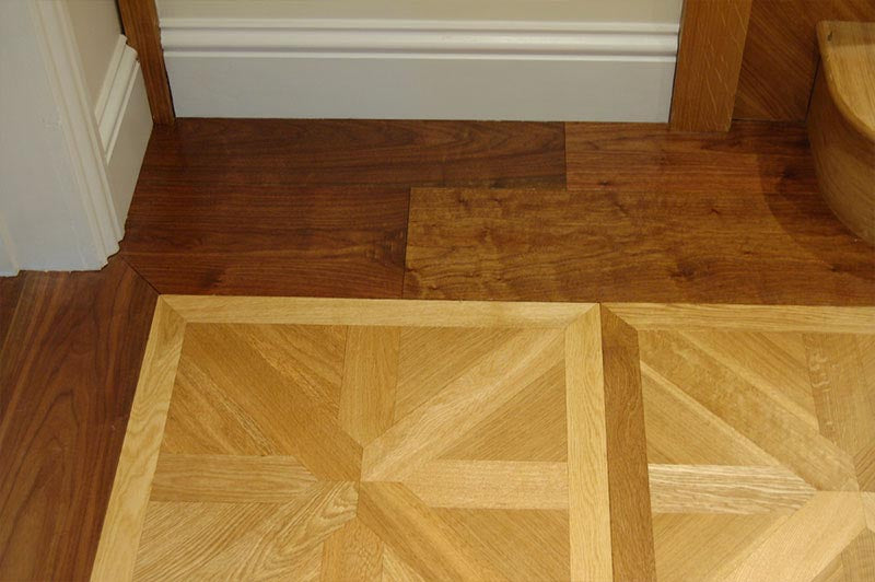 parquet panels with a dark walnut border