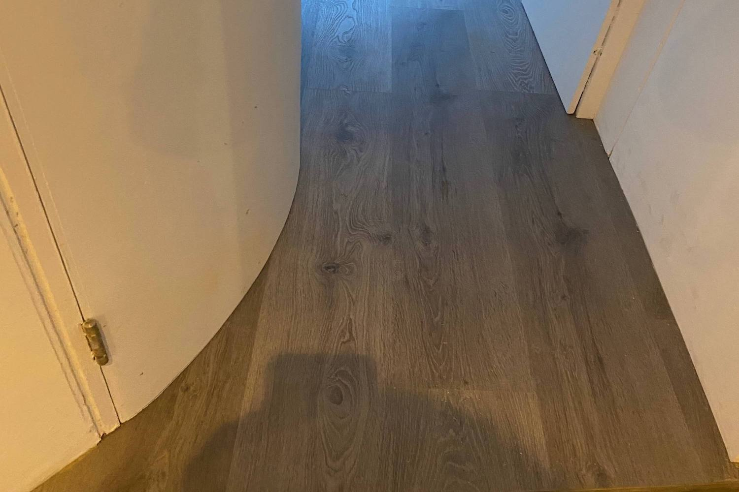Impervia French Grey Luxury Flooring push fit cutting around corners
