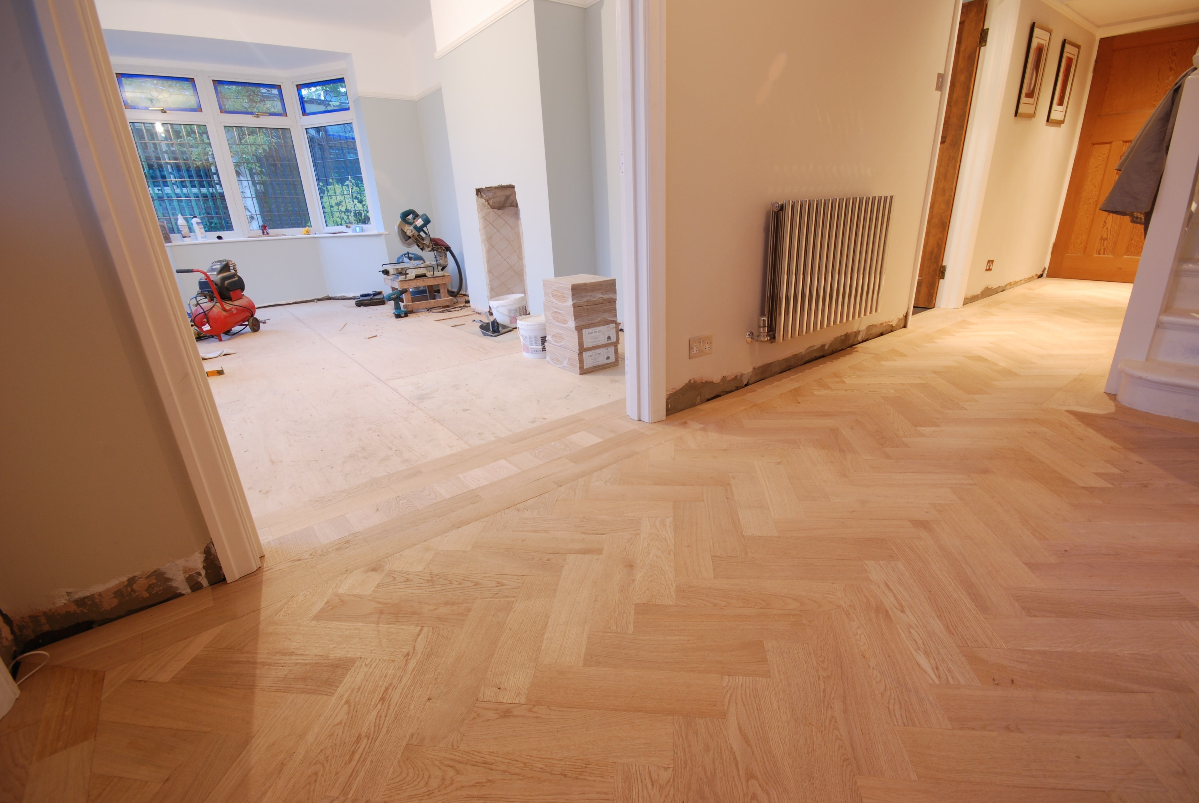 Overlay parquet flooring being fitted
