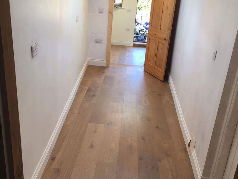 Double brushed and fumed E156 in a hallway