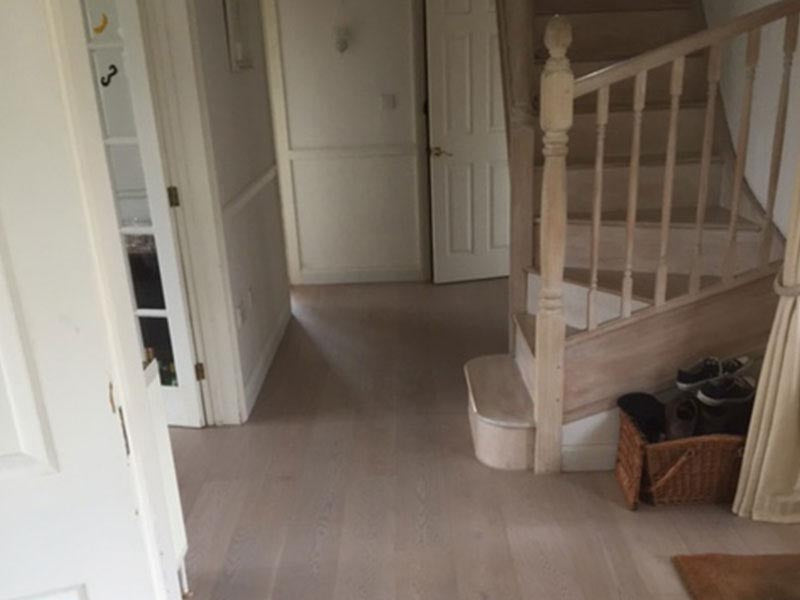 Lacquered Select Grade wood floor by stairs