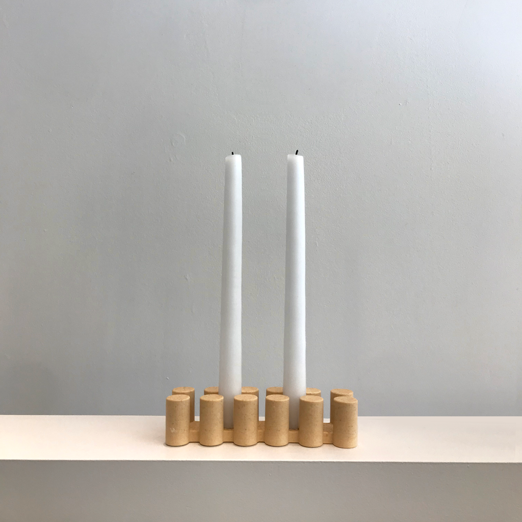 A candle holder with candles from Studio Den Den made with Sand from Block Island
