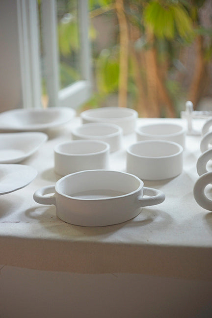 Ceramics drying by a window at the Studio of AManda Lucia Cote in Los Angeles California