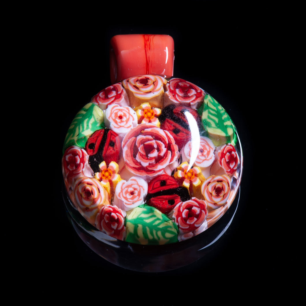 This Artisan Pink / Peach Milliefiori Lampwork Flamework glass pendant necklace