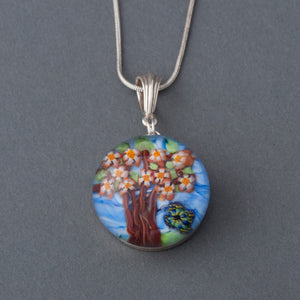 This Artisan Cherry Tree and Butterfly Lampwork Flamework glass pendant necklace