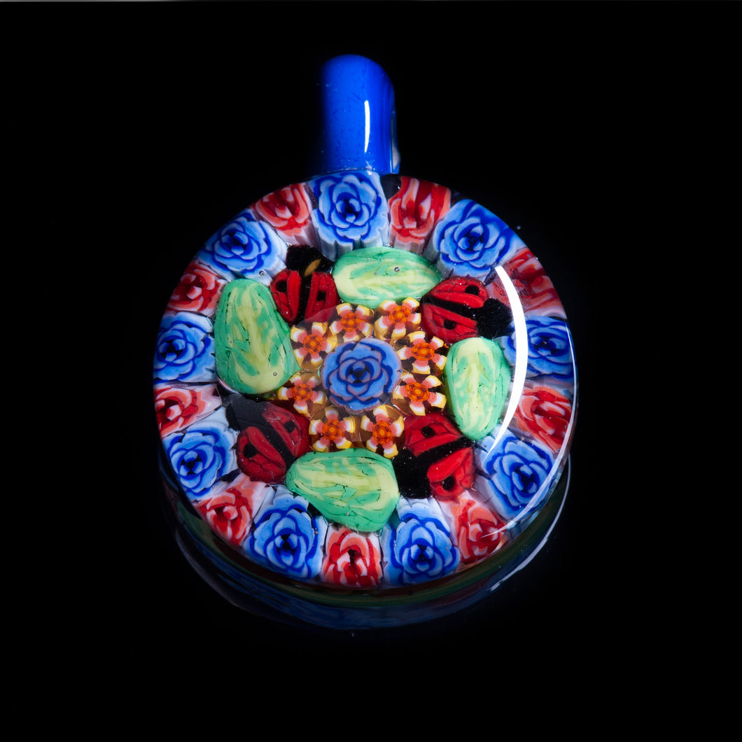 This Artisan Blue with Ladybug Milliefiori Lampwork Flamework glass pendant necklace