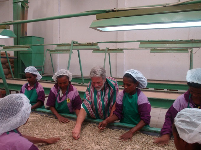 Dean sorts beans with women farmers
