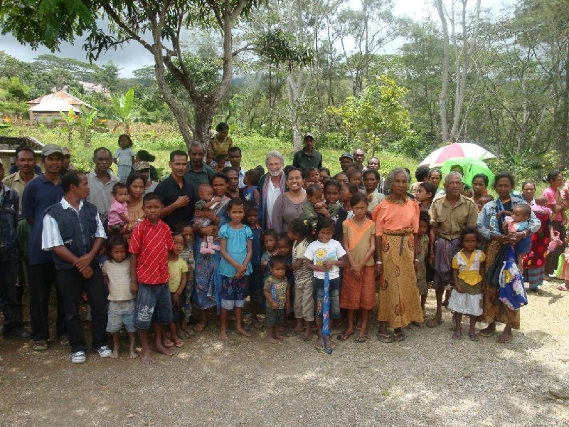 Dean with a large group of farmers and children