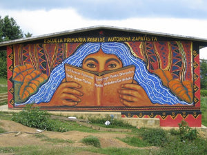 A mural featuring a person with long blue hair reading a book