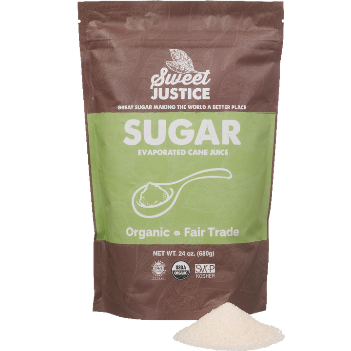 A bag of Sweet Justice Sugar, with a small pile of sugar in front