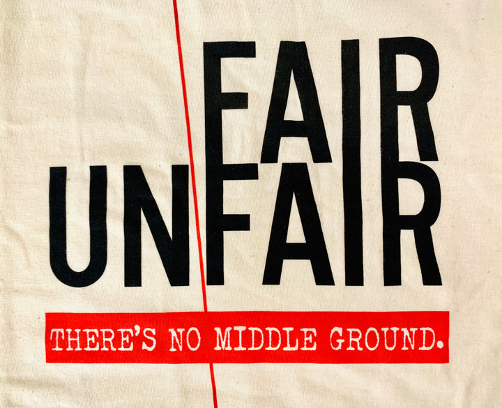 "Cream T-Shirt with ""Fair/Unfair: There's no middle ground"" Slogan Front"