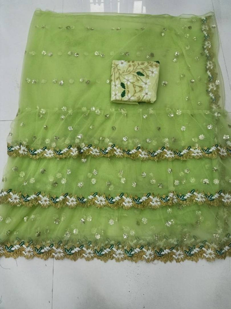 Beautiful Net Embroidered Ruffle Saree with Blouse piece