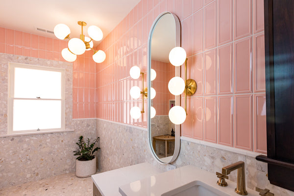 Bold and colorful bathroom, custom mirror by Edgework Creative